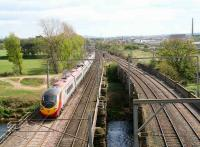 Glasgow-Euston Pendolino service crossing the River Eden at Etterby on the original bridge built to carry the WCML.<br><br>[John Furnevel&nbsp;18/04/2007]