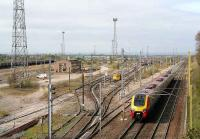 View north over Carlisle Kingmoor yard in April 2007 with a Voyager heading north on the WCML.<br><br>[John Furnevel&nbsp;18/04/2007]
