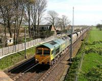 Northbound coal empties passing the site of Rockcliffe station just north of Carlisle in April 2007. The much modified former station house still stands on the left and the floodlights of Kingmoor yard can be seen in the right background.<br><br>[John Furnevel&nbsp;18/04/2007]