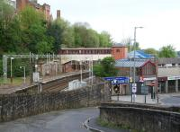 Looking west over Port Glasgow station on 29 April 2007 from the short-cut to Springhill Road. The main station entrance is located on Princes Street, lower right and gives access to a ramp leading up to platform level. [See image 14815]<br><br>[John Furnevel&nbsp;29/04/2007]