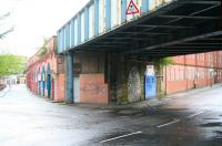 View south along Molendinar Street towards Gallowgate on a wet 6 May 2007, with Bell Street running off to the right. Below the bridge is the infilled arch that once formed the entrance to Gallowgate station (closed 1902). The bridge still carries the CGU line north towards High Street East Junction. <br><br>[John Furnevel&nbsp;06/05/2007]
