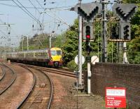 Looking north from the Largs side at Kilwinning station on 3 May as a train from Glasgow Central approaches the Ayr platforms. <br><br>[John Furnevel&nbsp;3/05/2007]