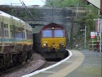 66236 thundering through Johnstone station with coal empties for Hunterston<br><br>[Graham Morgan&nbsp;25/04/2007]