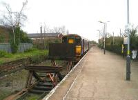 Once a through route for Liverpool - Scotland services, Ormskirk station, now a single line with 2 sets of buffer-stops, is seen on 09 January 2007. The diesel unit has just arrived on a service from Preston, while Merseyrail electric services into Liverpool depart from the other end of the platform behind the camera.  <br><br>[John McIntyre&nbsp;09/01/2007]