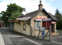 <I>What's this... a new ScotRail long-distance service?</I> The converted station building on the southbound platform at Busby in May 2007, now in use as a Chinese takeaway.<br><br>[John Furnevel&nbsp;06/05/2007]