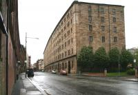 Built in the mid 1870s by the City of Glasgow Union on the site of the Old College of the University of Glasgow, the former College Goods warehouse still stands as housing on Bell Street. View west towards High Street, May 2007.<br><br>[John Furnevel&nbsp;06/05/2007]