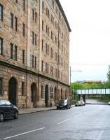 Looking east along Bell Street in May 2007, showing the former College Goods warehouse. The plate girder bridge carries the CGU line north towards High Street East Junction, with the entrance to the old Gallowgate station just off picture to the right below the bridge [see image 14887].<br><br>[John Furnevel&nbsp;06/05/2007]