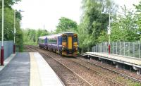 A train for East Kilbride pulls into Giffnock on 6 May 2007 under the recently repainted footbridge.<br><br>[John Furnevel&nbsp;06/05/2007]
