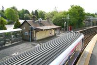 View over Busby station on 6 May 2007 towards the former station building, now the <I>Shanghai Express</I> takeaway. A train for Glasgow Central is just leaving the northbound platform.<br><br>[John Furnevel&nbsp;06/05/2007]
