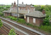 The down platform buildings at East Linton on 16 May 2007 standing alongside the ECML. Beyond is the fine looking 1846 main station building.<br><br>[John Furnevel&nbsp;16/05/2007]