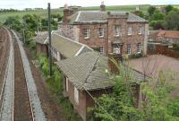 Looking east along the ECML from the old station footbridge at East Linton on 16 May 2007. The surviving platform buildings connect to the substantial structure incorporating the former <I>Station House</I> beyond.<br><br>[John Furnevel&nbsp;16/05/2007]