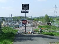 <i>End of the line?</i> The trackbed at North Johnstone comes to an abrupt halt, the site for the almost complete <i>Morrison</i> superstore taking its place. The original Johnstone North station was located where the pylon to the right stands  <br><br>[Graham Morgan&nbsp;04/05/2007]