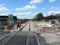 Looking west from the rubber surfaced level crossing. Workers are running cables from the conduit on left of track to under the base of a signal relay cabinet.<br><br>[Brian Forbes&nbsp;21/05/2007]