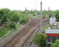View west at Holm Junction, Ardrossan, in May 2007. From left to right are the lines to Ardrossan Harbour, the former line to the sidings and shed, the passenger line to Largs and the freight only line used mainly by the Hunterston coal trains.<br><br>[John Furnevel&nbsp;17/05/2007]