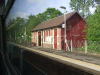 Platform 1 waiting rooms buildings at Pollokshaws West. Taken from a passing train<br><br>[Graham Morgan&nbsp;07/05/2007]