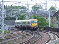 334003 crossing Wallneuk Junction at Paisley Gilmour Street with a service for Gourock<br><br>[Graham Morgan&nbsp;22/05/2007]