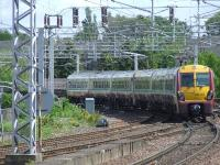 334011 crosses Wallneuk Junction at the rear of a two unit set as it heads for Glasgow Central<br><br>[Graham Morgan&nbsp;22/05/2007]