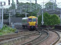 334017 crosses Wallneuk Junction as it pulls away from Paisley Gilmour Street heading for Glasgow Central<br><br>[Graham Morgan&nbsp;22/05/2007]