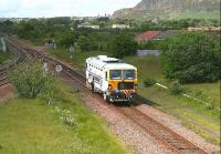 Track maintenance unit takes the sub at Niddrie West Junction on 25 May and heads along the single line section to Portobello.<br><br>[John Furnevel&nbsp;25/05/2007]