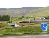 Glasgow - Euston Pendolino runs past a PW squad alongside the M74 near Crawford on 22 May 2007.<br><br>[John Furnevel&nbsp;22/05/2007]