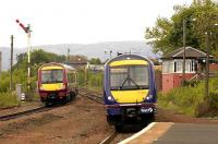 Trains for Stirling and Glasgow Queen Street pass at Larbert North on 28 May. <br><br>[Bill Roberton&nbsp;28/05/2007]
