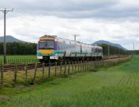 170 403 in Scotrail colours heads for Cupar, about to pass Bow Of Fife L.C. The peaks are East(L) & West(R) Lomond Hills.<br><br>[Brian Forbes&nbsp;28/05/2007]
