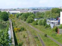 Kirkland East Loop from Bawbee Bridge, a  view of what might be the new site for a Levenmouth area station. The original main line turned to the right at the factory top centre, to Leven station (cl.1969) and the Fife Coast Line. The River Leven can be seen on the left.<br><br>[Brian Forbes&nbsp;01/06/2007]