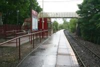 Looking towards Glasgow Central on 20 May 2007 along the platform of a wet Mosspark station.<br><br>[John Furnevel&nbsp;20/05/2007]