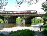 A morning Glasgow Central - Carlisle service crosses the River Nith on 1 June 2007 as it begins to slow for the Dumfries stop.<br><br>[John Furnevel&nbsp;01/06/2007]
