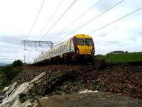 334039 passes with a Helensburgh - Drumgelloch service on 29 May near Ardoch.<br><br>[John McIntyre&nbsp;29/05/2007]