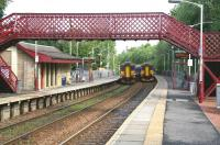 Trains on the East Kilbride line pass at Giffnock station on 6 May 2007. <br><br>[John Furnevel&nbsp;/05/2007]