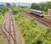 Looking towards Edinburgh in July 2007 with the Edinburgh - Glasgow main line on the right and the current SRPS line to Boness coming in from the left - with a wire fence between.<br><br>[John Furnevel&nbsp;07/07/2007]