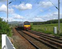 320309 Glasgow bound at Ardmore East LC on 28 May.<br><br>[John McIntyre&nbsp;28/05/2007]