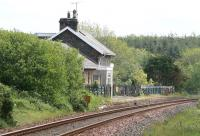 Looking east from the level crossing at Castle Kennedy on 31 May showing the platform remains and converted station building.<br><br>[John Furnevel 31/05/2007]