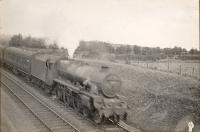 Glasgow - Stranraer express approaching Dalrymple Junction. 5X 4.6.0 5636 <i>Uganda</i>. Raeburn and Webb on Footplate.<br><br>[G H Robin collection by courtesy of the Mitchell Library, Glasgow&nbsp;/09/1940]