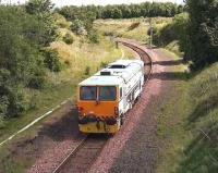 A track machine heads along the single line section of the <I>sub</I> between Niddrie West Junction and Brunstane on 25 May 2007. <br><br>[John Furnevel&nbsp;25/05/2007]