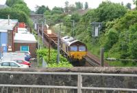 A Sunday morning PW train heads towards Glasgow after passing through Milliken Park station on 17 June 2007. EWS 66016 brings up the rear of the train. <br><br>[John Furnevel&nbsp;17/06/2007]