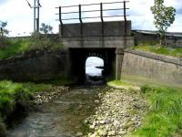 Bridge taking the line over a stream running south into the Clyde at Craigendoran. The abandoned original arched structure can be seen beyond. 28 May 2007.<br><br>[John McIntyre&nbsp;28/05/2007]
