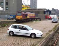 67011 stabled at the west end of Guild Street yard in June 2007 with Market Street and the docks beyond. No idea what happened to the car!<br><br>[Mick Golightly /06/2007]