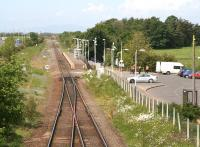 Looking towards Annan from Gretna and the start of the single line section on 30 May 2007. Some trackbed clearance has been carried out while on the right a <I>hit squad</I> has just arrived in the car park to undertake routine station cleaning and maintenance.<br><br>[John Furnevel&nbsp;30/05/2007]