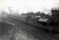 N.B. 4.4.0 62498 <i>Glen Moidart</i> banked by 0.6.2T 9148 on Polmont Train.<br><br>[G H Robin collection by courtesy of the Mitchell Library, Glasgow&nbsp;20/09/1948]