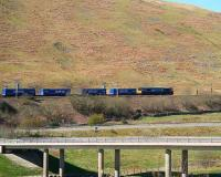 DRS 66 with the Tesco containers on Beattock Bank near Greskine in April 2007.<br><br>[John Furnevel&nbsp;/04/2007]