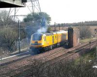 The Network Measurement Train leaves an exhaust trail over the former Niddrie North Junction in March 2007 as it turns towards Millerhill.<br><br>[John Furnevel&nbsp;31/03/2007]