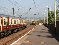 An Ayr - Glasgow train pulls out of Prestwick Town as a southbound train approaches the station in May 2007.<br><br>[John Furnevel 03/05/2007]