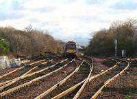 Train for Haymarket heading past the loops and sidings south of Dalmeny station in January 2007.<br><br>[John Furnevel&nbsp;10/01/2007]