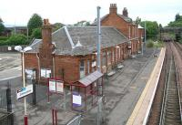 The station building at Johnstone, Renfrewshire, on a Sunday morning in June 2007. View is north east towards Paisley and Glasgow Central.<br><br>[John Furnevel&nbsp;17/06/2007]