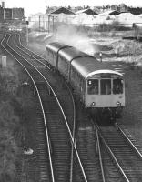 A diverted Edinburgh - North Berwick DMU at Lochend South Junction in 1987. The trackbed heading off to the right ran to Leith Central.<br><br>[Bill Roberton&nbsp;//1987]