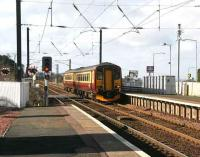 Train from Glasgow Central runs over the crossing into Kirknewton station in March 2007 on its journey to Waverley. <br><br>[John Furnevel&nbsp;/03/2007]