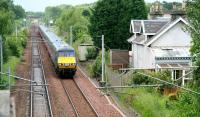 A GNER Glasgow Central - Kings Cross service passing the former station at Braidwood, South Lanarkshire (closed July 1962) on 28 June 2007.<br><br>[John Furnevel&nbsp;28/06/2007]