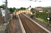 View south west over Glengarnock station towards Dalry on 17 June 2007. Originally opened as Glengarnock and Kilbirnie in 1840, it became plain Glengarnock in 1905. <br><br>[John Furnevel&nbsp;17/06/2007]